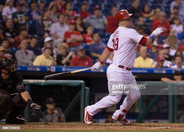 Cameron Rupp of the Philadelphia Phillies hits a solo home run in the bottom of the fifth inning against the Arizona Diamondbacks at Citizens Bank...