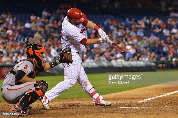 Cameron Rupp of the Philadelphia Phillies hits a three run home run in the eighth inning against the San Francisco Giants at Citizens Bank Park on...