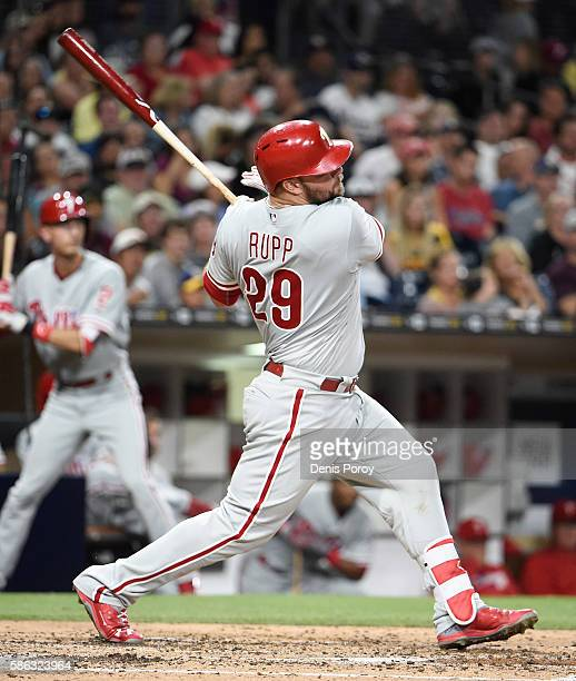 Cameron Rupp of the Philadelphia Phillies hits a threerun home run during the fourth inning of a baseball game against the San Diego Padres at PETCO...