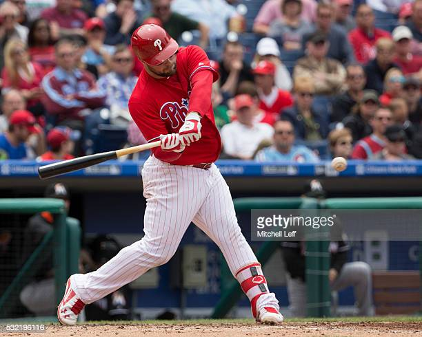 Cameron Rupp of the Philadelphia Phillies hits a two RBI single in the bottom of the third inning against the Miami Marlins at Citizens Bank Park on...