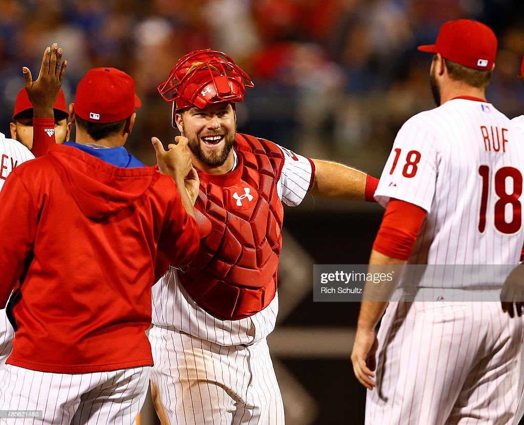 Cameron Rupp #29 of the Philadelphia Phillies is congratulated by teammates after the Phillies defeated the San Diego Padres 7-1 in a MLB game at Citizens Bank Park on August 28, 2015 in Philadelphia, Pennsylvania.