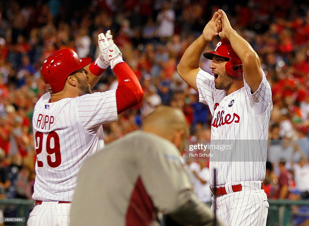 Cameron Rupp #29 of the Philadelphia Phillies is congratulated by Jeff Francoeur #3 after hitting a three run home run during the eighth inning of a MLB game at Citizens Bank Park on August 28, 2015 in Philadelphia, Pennsylvania. The Phillies defeated the Padres 7-1.