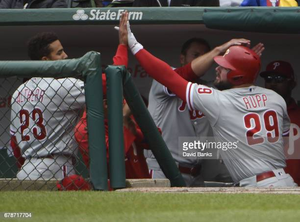Cameron Rupp of the Philadelphia Phillies is greeted by Aaron Altherr after hitting a home run against the Chicago Cubs during the eighth inning on...