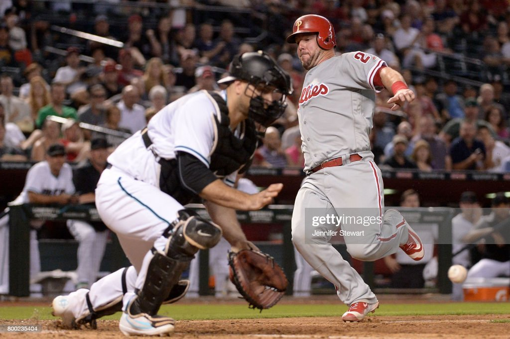 Cameron Rupp #29 of the Philadelphia Phillies slides in front of Chris Iannetta #8 of the Arizona Diamondbacks in the ninth inning at Chase Field on June 23, 2017 in Phoenix, Arizona.