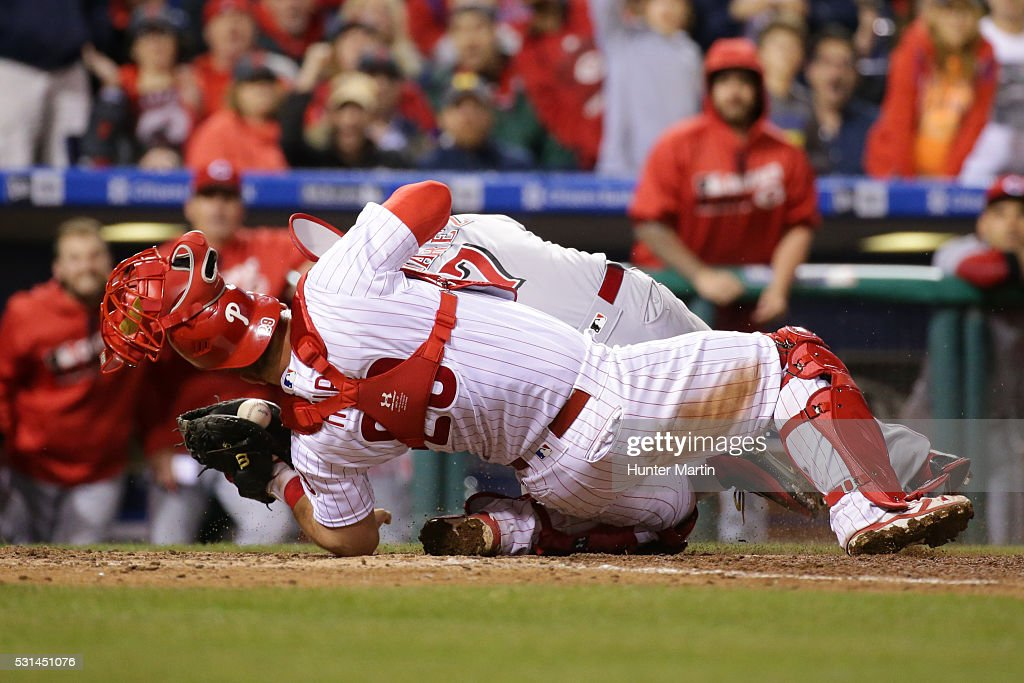 Cameron Rupp #29 of the Philadelphia Phillies tags out Eugenio Suarez #7 of the Cincinnati Reds during a collision at home plate in the ninth inning during a game at Citizens Bank Park on May 14, 2016 in Philadelphia, Pennsylvania. The Phillies won 4-3.