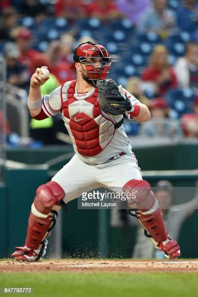 Cameron Rupp of the Philadelphia Phillies throws to second base during a baseball game against the Washington Nationals at Nationals Park on...