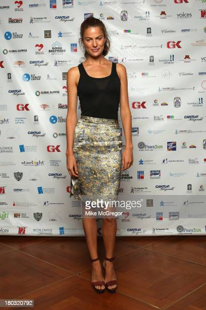 Cameron Russell attends the Annual Charity Day Hosted By Cantor Fitzgerald And BGC at the Cantor Fitzgerald Office on September 11 2013 in New York...