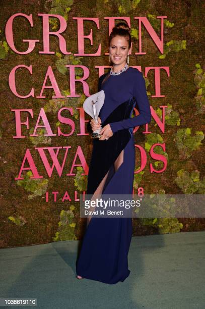 Cameron Russell winner of The Changemaker Award poses backstage at The Green Carpet Fashion Awards Italia 2018 at Teatro Alla Scala on September 23...