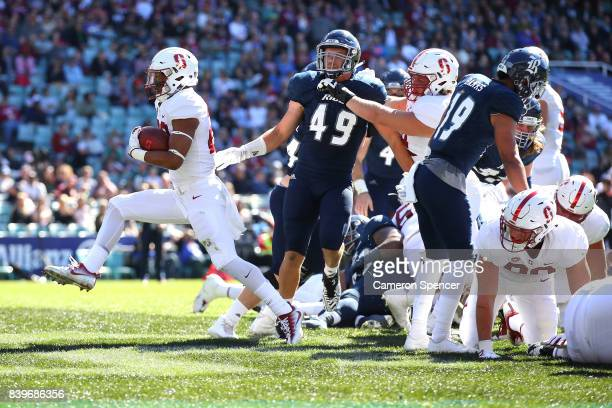 Cameron Scarlett of Stanford scores a touchdown during the College Football Sydney Cup match between Stanford University and Rice University at...