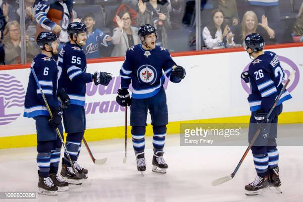 Cameron Schilling Mark Scheifele Nikolaj Ehlers and Blake Wheeler of the Winnipeg Jets celebrate a second period goal against the Chicago Blackhawks...