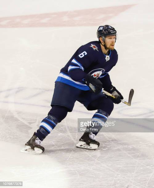 Cameron Schilling of the Winnipeg Jets follows the play up the ice during second period action against the Chicago Blackhawks at the Bell MTS Place...