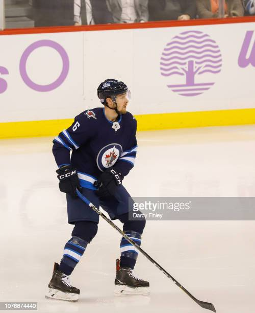 Cameron Schilling of the Winnipeg Jets keeps an eye on the play during second period action against the Chicago Blackhawks at the Bell MTS Place on...