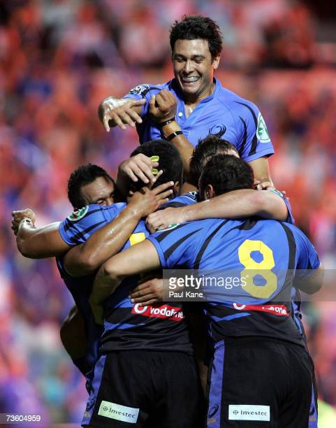 Cameron Shepherd of the Force celebrates with team mates after defeating the Reds 38-3 during the round seven Super 14 match between the Western...