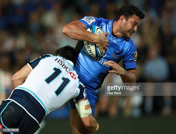 Cameron Shepherd of the Force gets tackled by Adam AshleyCooper of the Waratahs during the round seven Super Rugby match between the Force and the...