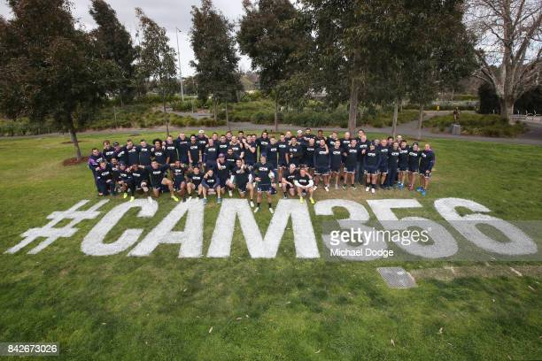 Cameron Smith about to play his record breaking 356th match poses with teammates during a Melbourne Storm NRL training session at AAMI Park on...