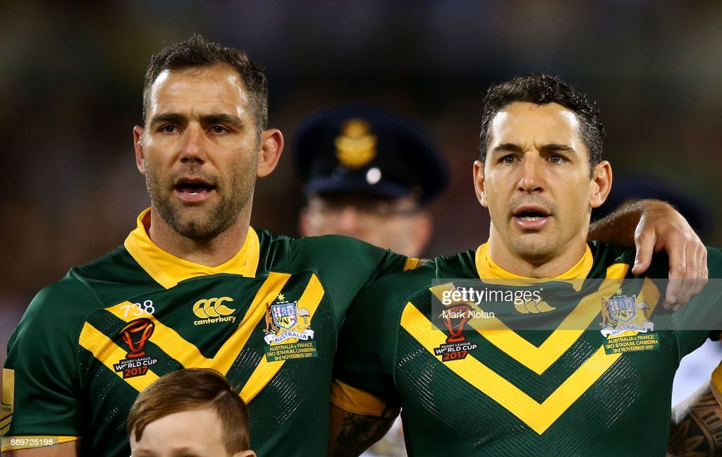 Cameron Smith and Billy Slater of Australia sing the national anthem before the 2017 Rugby League World Cup match between Australian Kangaroos and France at Canberra Stadium on November 3, 2017 in Canberra, Australia.