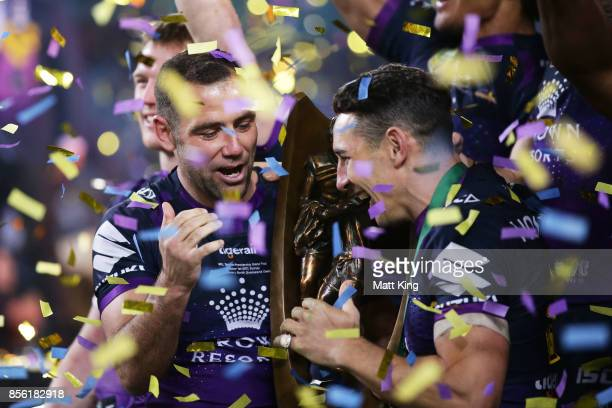 Cameron Smith and Billy Slater of the Storm celebrate and holds aloft the NRL Premiership trophy after victory in the 2017 NRL Grand Final match...