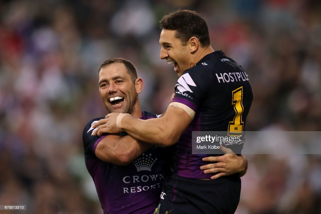 Cameron Smith and Billy Slater of the Storm celebrate Slater scoring a try during the round nine NRL match between the St George Illawarra Dragons and the Melbourne Storm at WIN Stadium on April 30, 2017 in Wollongong, Australia.
