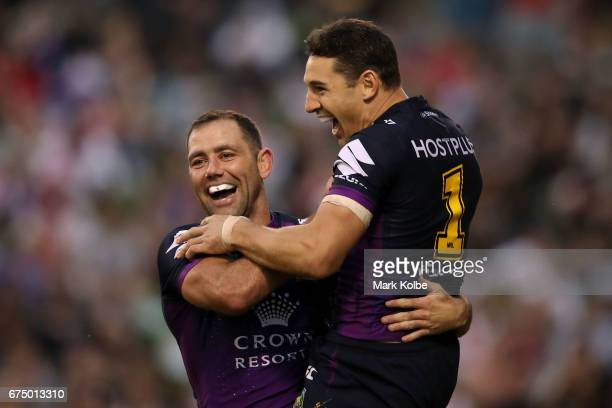 Cameron Smith and Billy Slater of the Storm celebrate Slater scoring a try during the round nine NRL match between the St George Illawarra Dragons...