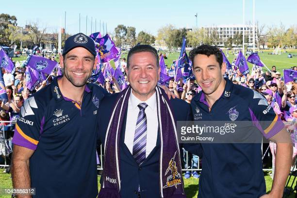 Cameron Smith and Billy Slater of the Storm pose for a photo with Minister for Sport John Eren during the Melbourne Storm Fan Day at Gosch's Paddock...