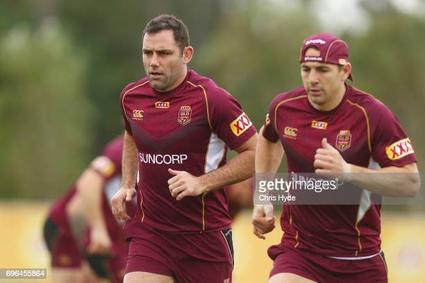 Cameron Smith and Billy Slater run during a Queensland Maroons State of Origin training session at Intercontinental Sanctuary Cove Resort on June 16...