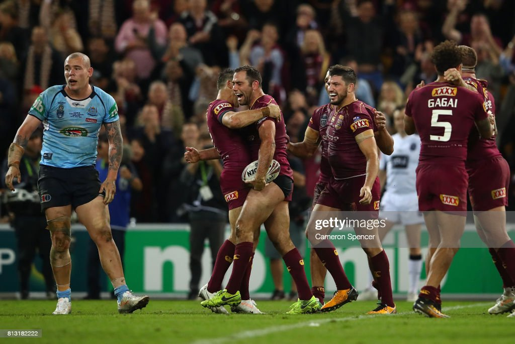 Cameron Smith and Cooper Cronk of the Maroons celebrate winning game three of the State Of Origin series between the Queensland Maroons and the New South Wales Blues at Suncorp Stadium on July 12, 2017 in Brisbane, Australia.