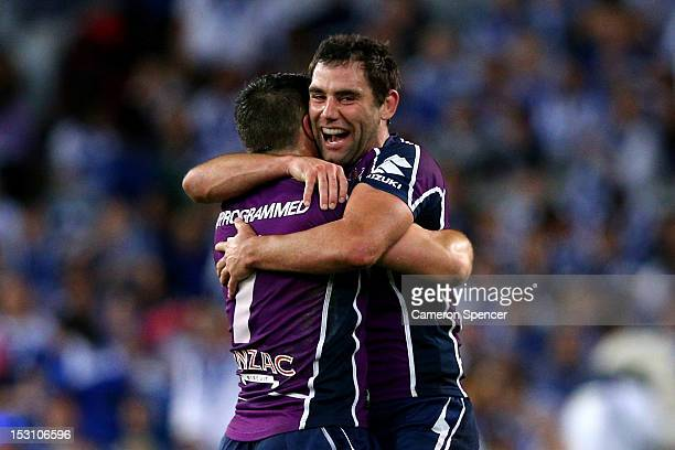 Cameron Smith and Cooper Cronk of the Storm celebrate at full-time after winning the 2012 NRL Grand Final match between the Melbourne Storm and the...