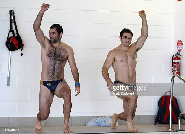 Cameron Smith and Cooper Cronk of the Storm exercise on the pool deck during a Melbourne Storm NRL recovery session at AAMI Park on June 20 2011 in...