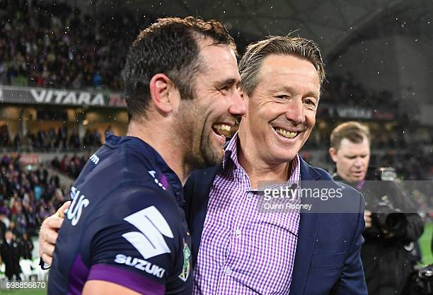 Cameron Smith and Craig Bellamy of the Storm celebrate winning the round 26 NRL match between the Melbourne Storm and the Cronulla Sharks at AAMI...