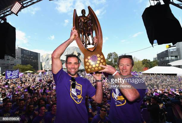 Cameron Smith and Craig Bellamy of the Storm hold up the NRL premiership trophy during the Melbourne Storm NRL Grand Final celebrations at Gosch's...