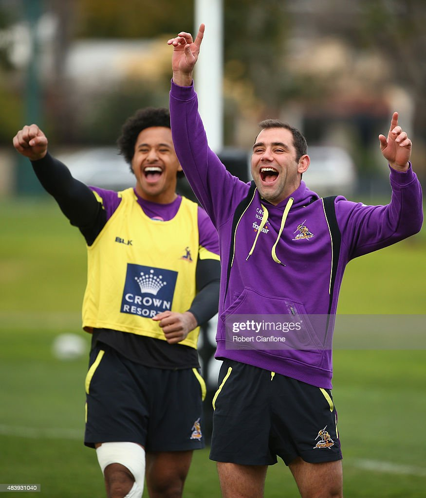 Cameron Smith and Felise Kaufusi of the Storm, laugh during a Melbourne Storm NRL training session at Gosch's Paddock on August 14, 2015 in Melbourne, Australia.