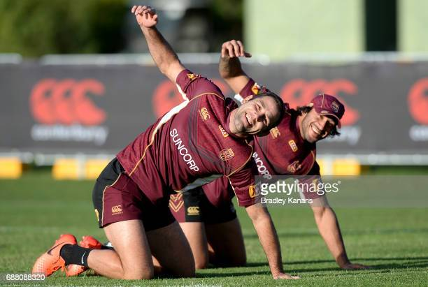 Cameron Smith and Johnathan Thurston stretch during a Queensland Maroons State of Origin training session at InterContinental Sanctuary Cove Resort...