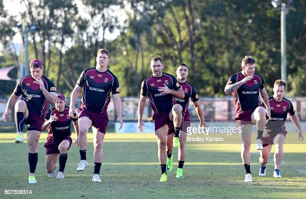 Cameron Smith and team mates warm up during a Queensland Maroons State of Origin training session at Langlands Park on July 4 2017 in Brisbane...