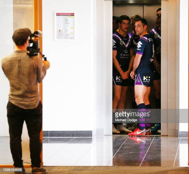 Cameron Smith and teammates come out of the lift for a Melbourne Storm NRL media opportunity at AAMI Park on September 24 2018 in Melbourne Australia...