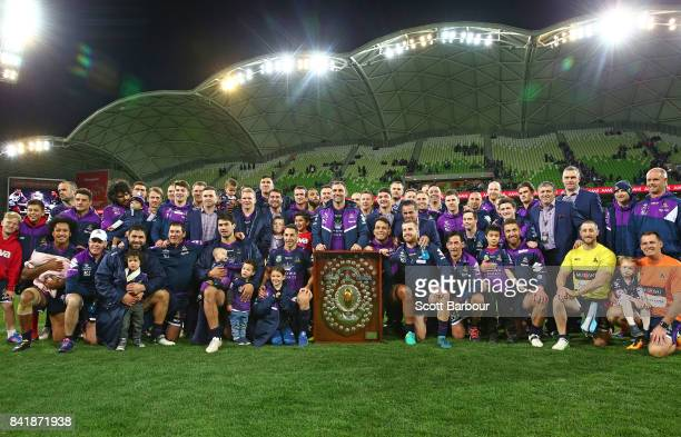 Cameron Smith and the Storm pose with the JJ Giltinan Shield as minor premiers after winning the round 26 NRL match between the Melbourne Storm and...