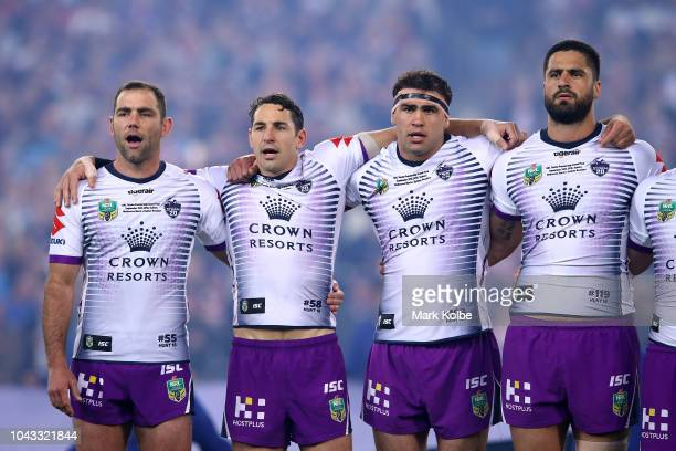 Cameron Smith Billy Slater Dale Finucane and Jesse Bromwich of the Storm sing the national anthem during the 2018 NRL Grand Final match between the...