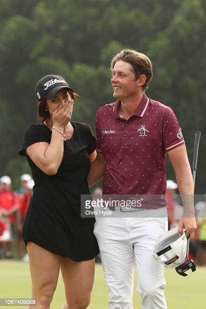 Cameron Smith celebrates with girlfriend Jordan after winning on day four of the 2018 Australian PGA Championship at Royal Pines Resort on December 2...