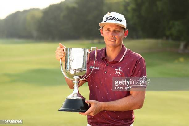 Cameron Smith holds the Joe Kirkwood Cup after winning on day four of the 2018 Australian PGA Championship at Royal Pines Resort on December 2 2018...