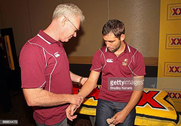 Cameron Smith is checked by the team doctor at the media call following the Queensland Maroons State of Origin I team announcement at the Sofitel...