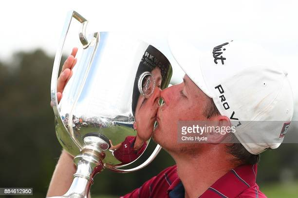 Cameron Smith kisses the Joe Kirkwood Cup after winning on day four of the 2017 Australian PGA Championship at Royal Pines Resort on December 3 2017...