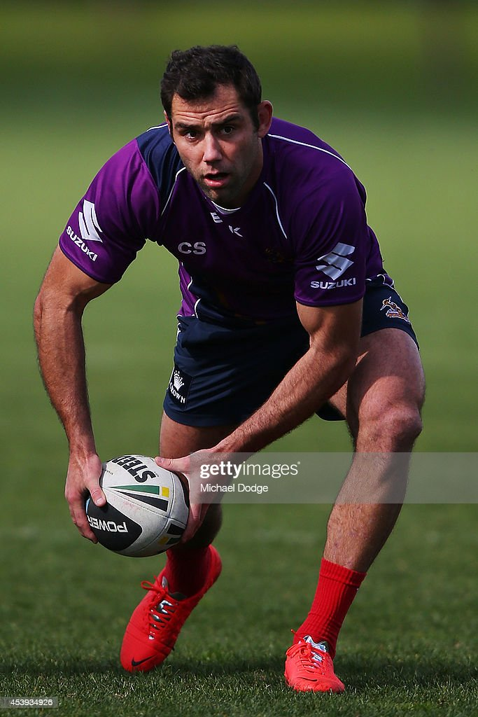Cameron Smith looks to pass the ball during a Melbourne Storm NRL training session at Gosch's Paddock on August 22, 2014 in Melbourne, Australia.