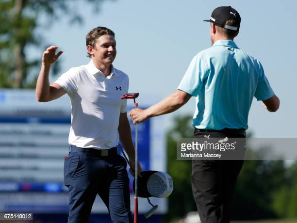 Cameron Smith of Australia and Jonas Blixt of Sweden react after putting in to win in a sudden-death playoff during a continuation of the final round...