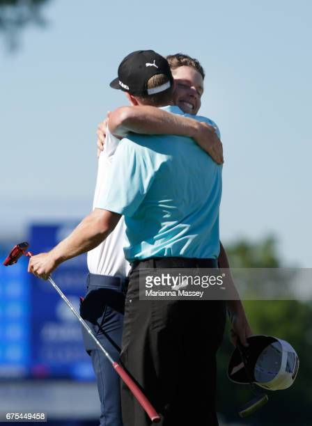 Cameron Smith of Australia and Jonas Blixt of Sweden react after putting in to win in a suddendeath playoff during a continuation of the final round...