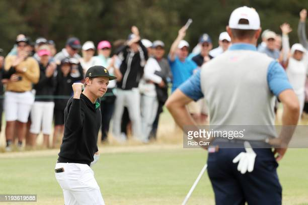 Cameron Smith of Australia and the International team celebrates his birdie on the first green as Gary Woodland of the United States team looks on...