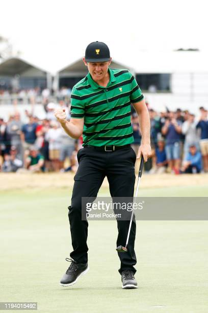 Cameron Smith of Australia and the International team celebrates defeating Justin Thomas of the United States team 21 during Sunday Singles matches...