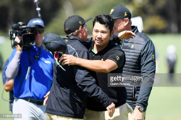 Cameron Smith of Australia and the International team congratulates Hideki Matsuyama of Japan and the International team after Matsuyama and CT Pan...
