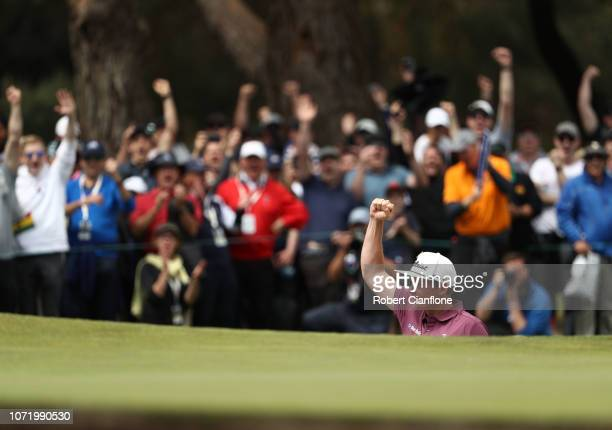 Cameron Smith of Australia celebrates sinking a shot out of the bunker on the 14th during day four of the 2018 World Cup of Golf at The Metropolitan...