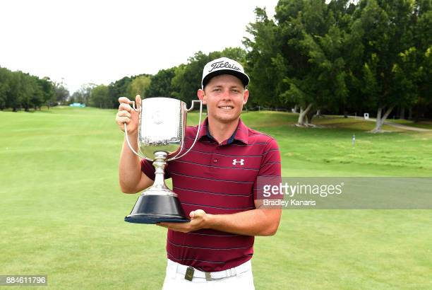 Cameron Smith of Australia celebrates victory as he holds up the Kirkwood Cup during day four of the 2017 Australian PGA Championship at Royal Pines...