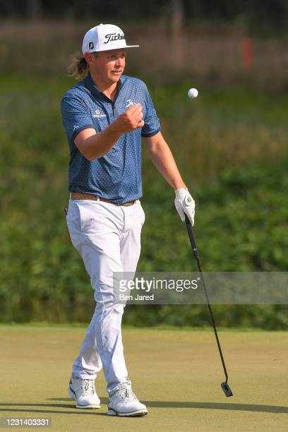 Cameron Smith of Australia flips his ball to his caddie on the 17th green during the second round of the World Golf Championships-Workday...