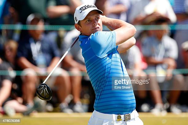 Cameron Smith of Australia hits his tee shot on the first hole during the final round of the 115th U.S. Open Championship at Chambers Bay on June 21,...